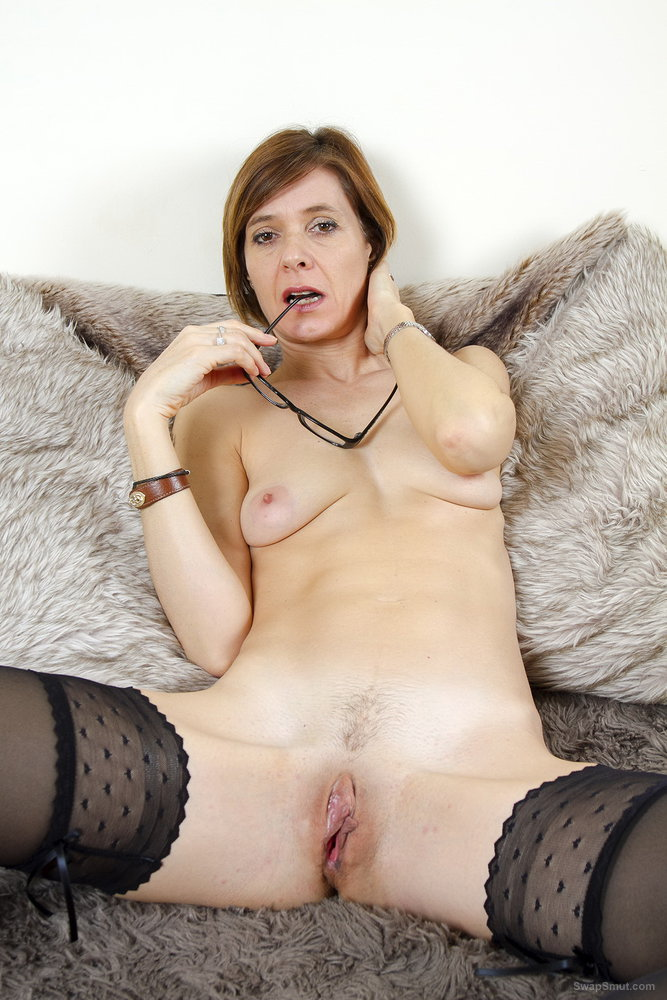 Milf wife nude on the sofa touching herself intimately