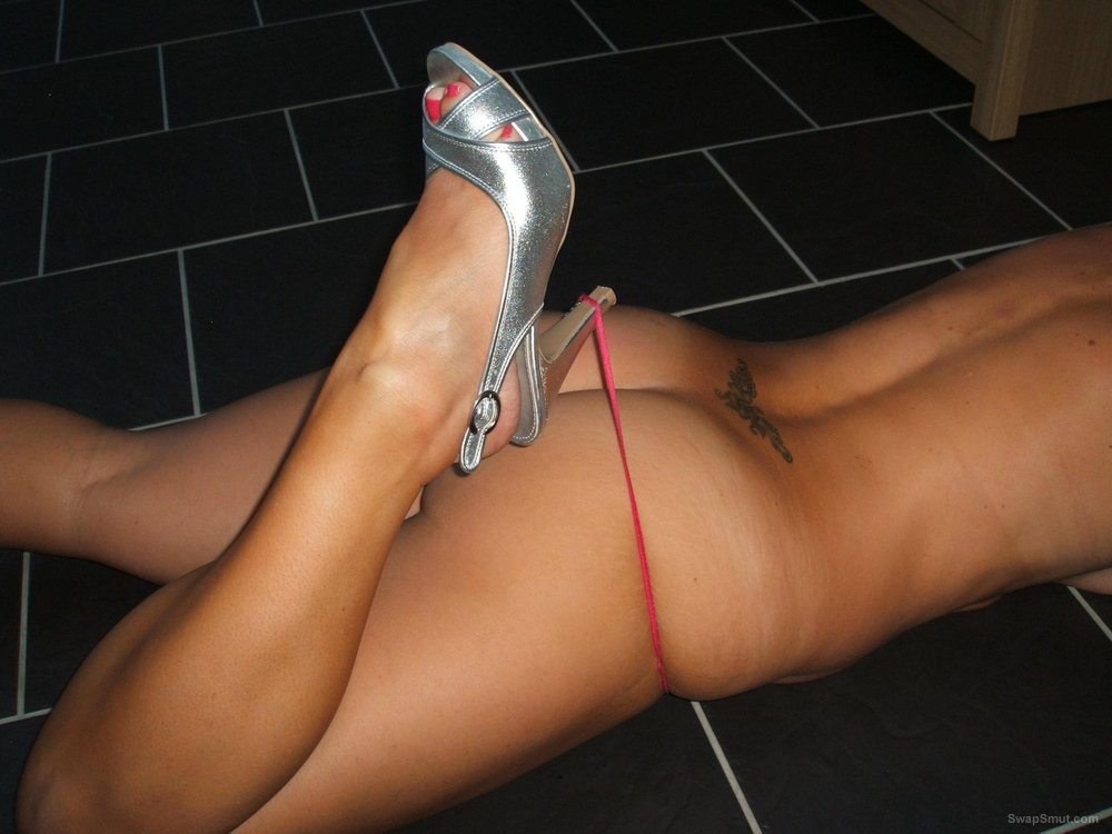 My milf posing seductively around the house in high heels