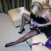 Milf in lingerie trying on a strapon dildo