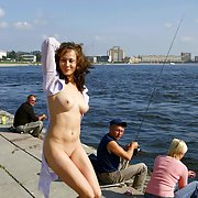 Busty russian girl on public pier and skatepark