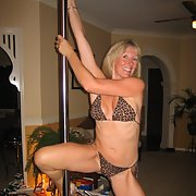 Stunning blonde milf having some adult fun pole dancing at home