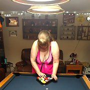 Wife in pink with big tits playing pool tits out