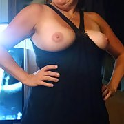 Nude wife vacation pictures flashing her pussy.