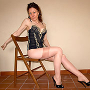Taking pics of her in stockings and high heels