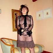 Mature French housewife posing around the house in her black lingerie