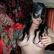 A naughty MILF dressed in sexy mask