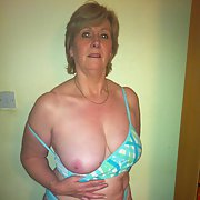 Mature karen sexy milf swimsuit stripping revealing breasts for you