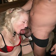 Tam loving to suck big black cock