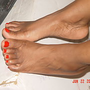My main girl Misty's feet with painted non pedicured red toes