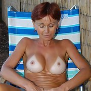 sexy redhead GILF teasing in public her nude body