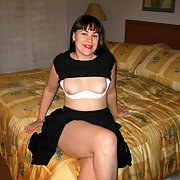 Milie Wears a Black Top and Skirt showing tits and knickers