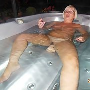A mature slut I met while on holiday dildo in hot tub spreading pussy