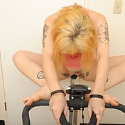 Self shot naked tattooed Goth girl fooling around with some gym gear