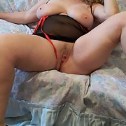 Sexy BBW wife posing for naughty pics exposing pussy and big boobs