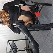 Crossdresser femdom in black open leather skirt and boots Part1