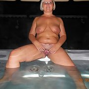 A mature slut I met while on holiday riding dildo in a hot tub