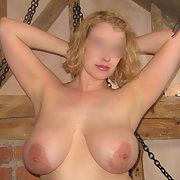 Slippery when wet oiled and chained in the attic on a hot day bondage