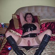 More of Deb in her PVC basque and boots posing for homemade photos