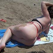 32 year old wife having photos taken on a beach in her bikini