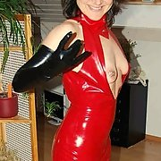 One serious fetishist dressed Anna in PVC for sex with him on a plastic sheet
