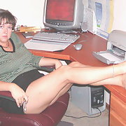 Sexy Mature Secretary Posing Nude at the office desk