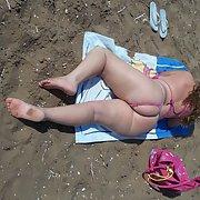 Sexy 32 year old wife in bikini on the beach having photos taken
