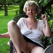 Ivana loves to relax naked in her garden