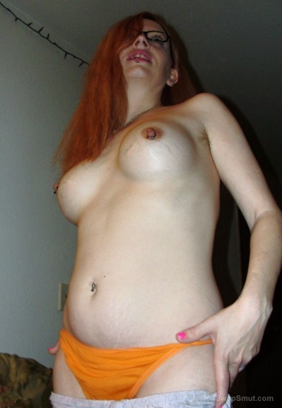 Slim and sexy hairy redhead removing her panties dress ginger pubes