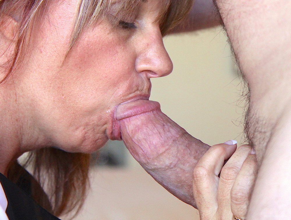 Naughty hotwife giving a big fat cock blowjob