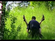 Sex among tall grass in a public park her legs in the air being fucked