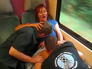 Horny mature bitch on a Train flirts with two passengers who give oral