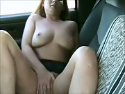 Horny milf masturbating outdoors in the car with a vibrator