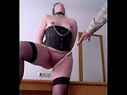 My young slave under master is training legs inside in the session