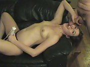 Sexy minx housewife toy in her hand and cock down throat