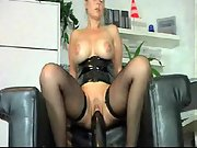 Perfect blonde riding a giant black dildo