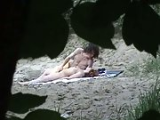 Voyeur camera capturing couple on beach having sex in public